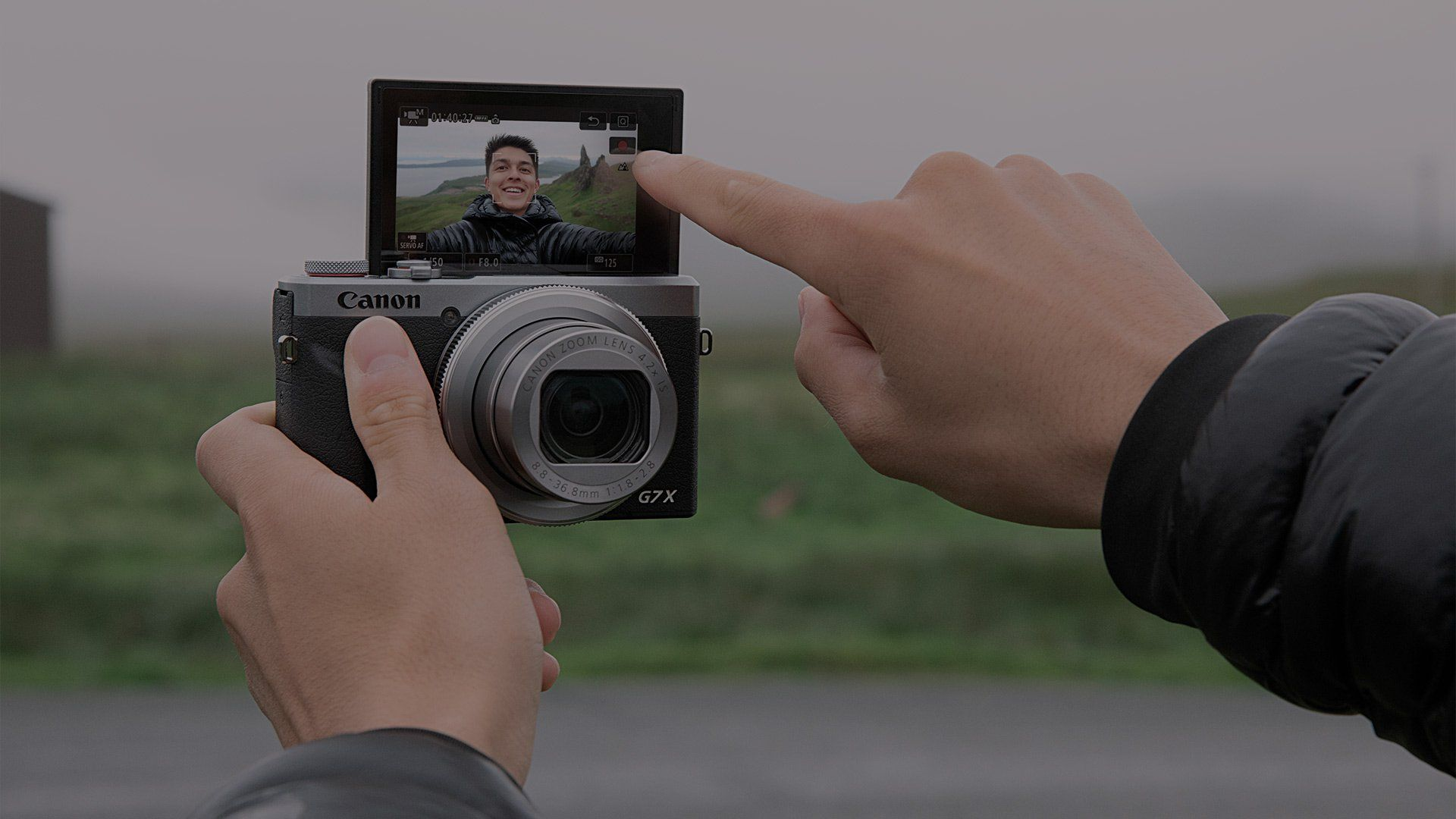 YouTube star and vlogger Mike Gray presses the Record button on the Canon PowerShot G7 X Mark III's touchscreen.